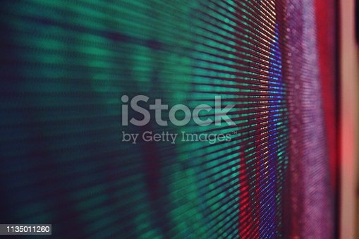 932724974 istock photo abstract Close up Bright colored LED SMD video wall abstract background 1135011260