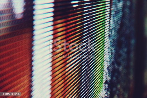 932724974 istock photo abstract Close up Bright colored LED SMD video wall abstract background 1135011269