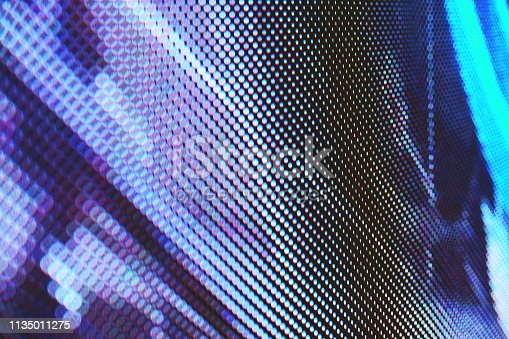 932724974 istock photo abstract Close up Bright colored LED SMD video wall abstract background 1135011275