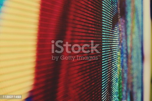 932724974 istock photo abstract Close up Bright colored LED SMD video wall abstract background 1135011493