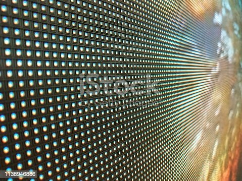 932724974 istock photo abstract Close up Bright colored LED SMD video wall abstract background 1138946886