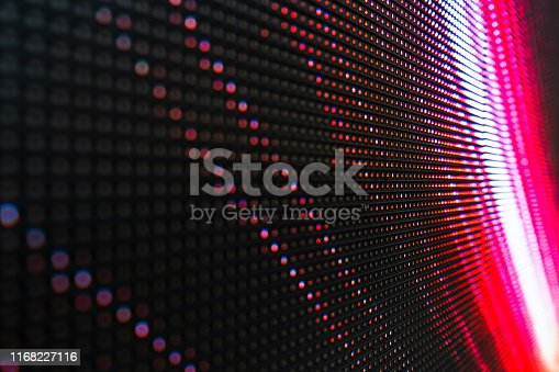 istock Abstract Close up Bright colored LED SMD video wall abstract background 1168227116