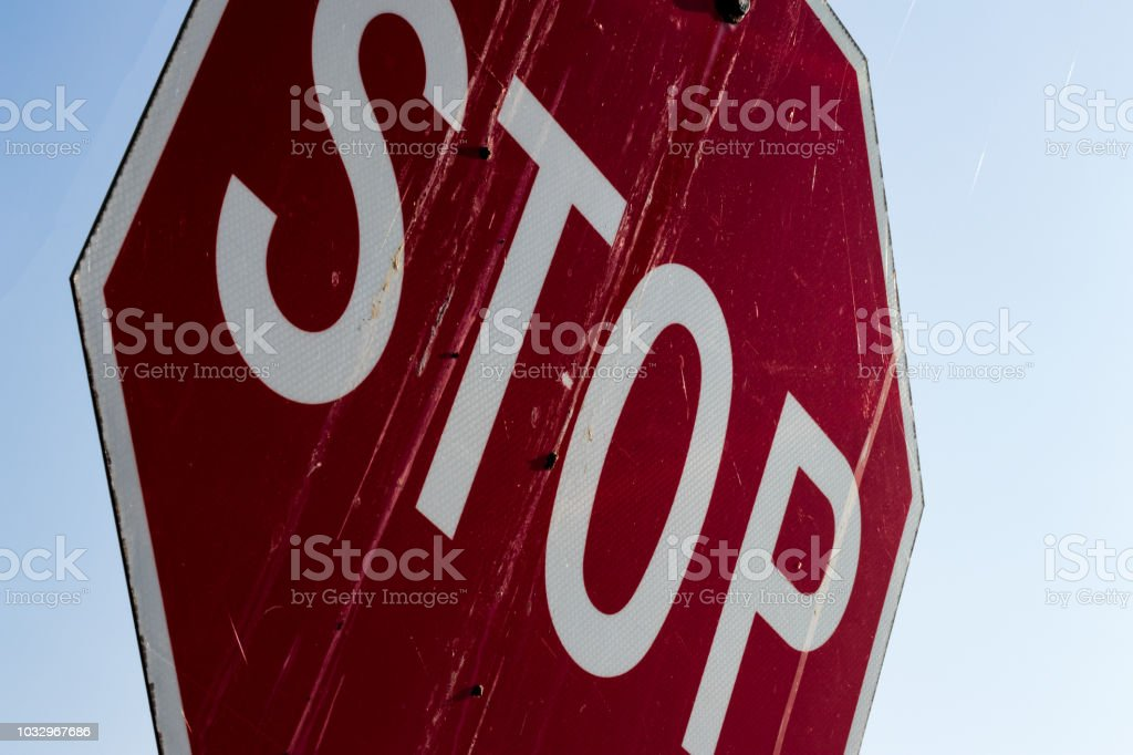 Abstract close up of an old dirty stop sign stock photo