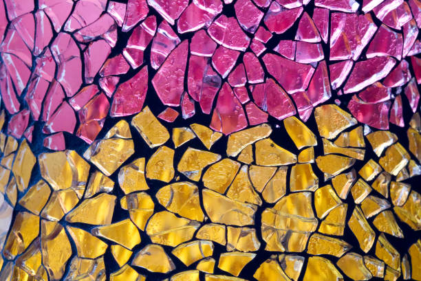Abstract close up of broken glass mosaic on a vase stock photo