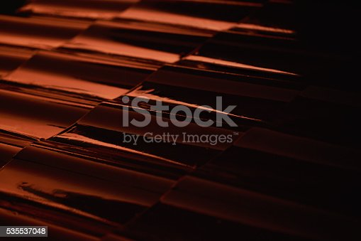 Abstract closeup metal profile roof-tile at sunset