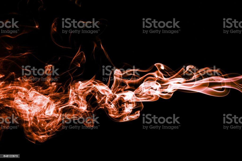 Abstract Color Smoke On Black Background Orange Smoke