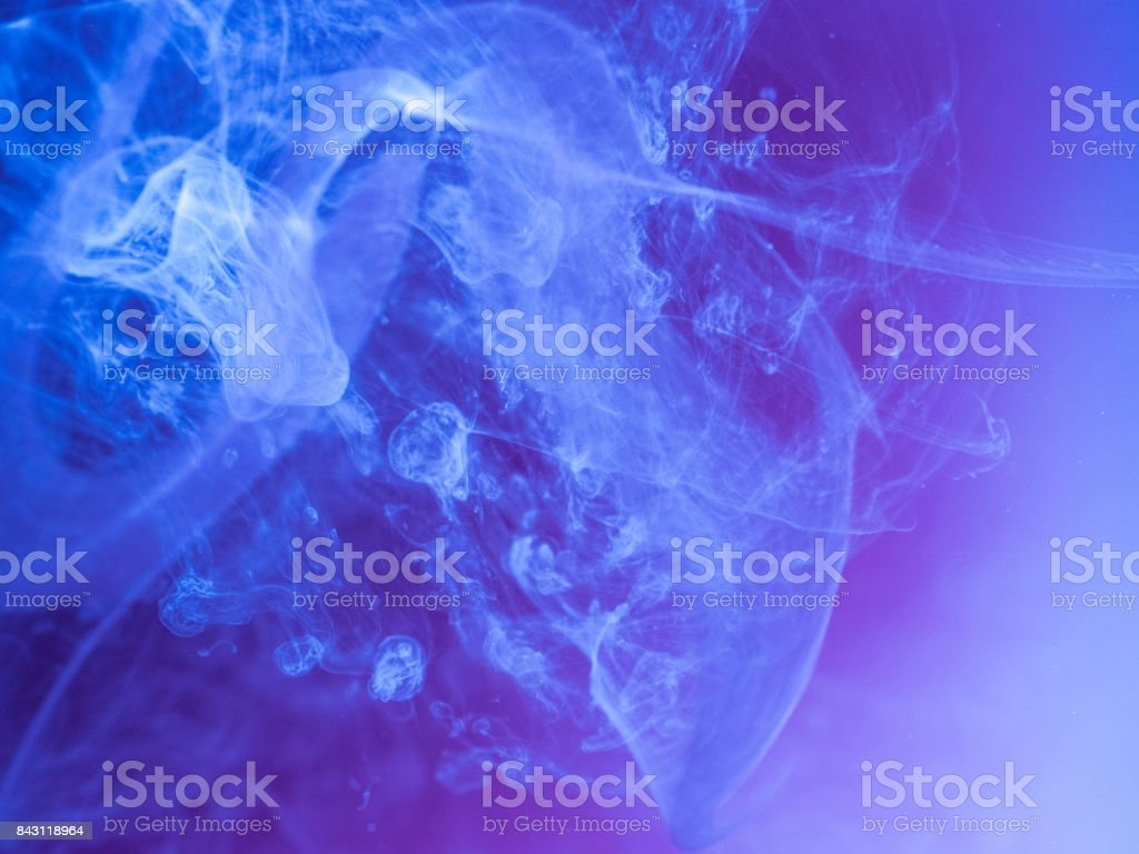 Abstract colored background. Blue smoke, ink in water, the patterns of the universe. Abstract movement, frozen multicolor flow of paint. Horizontal photo with soft focus, blurred backdrop stock photo