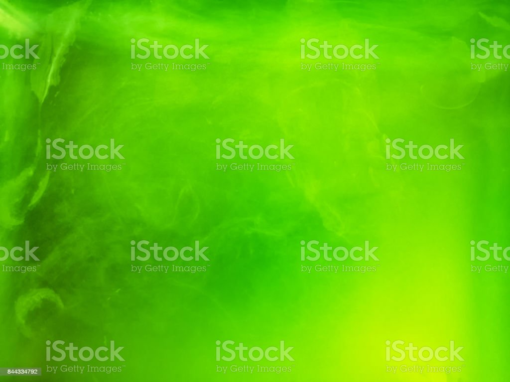Abstract colored background. Green smoke, ink in water, the patterns of the universe. Abstract movement, frozen multicolor flow of paint. Horizontal photo with soft focus, blurred backdrop stock photo