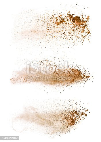Abstract colored brown powder explosion isolated on white background. High resolution texture