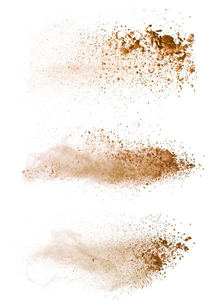 abstract colored brown powder explosion isolated on white background. - błoto zdjęcia i obrazy z banku zdjęć