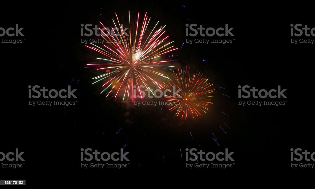 Abstract colored firework background with free space stock photo