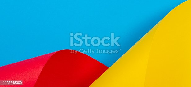 istock Abstract colorful background. Yellow red blue color paper in geometric shapes 1125748000
