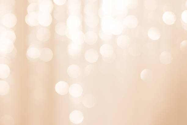 abstract colorful defocused background woth festive light bokeh - beige background stock photos and pictures