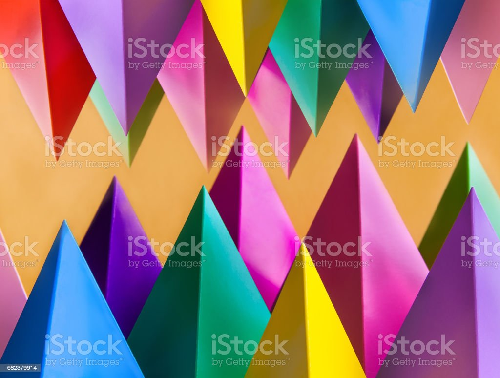 Abstract colorful geometric pattern with prism pyramid triangle shape figures. Yellow blue pink green violet red colored objects photo libre de droits