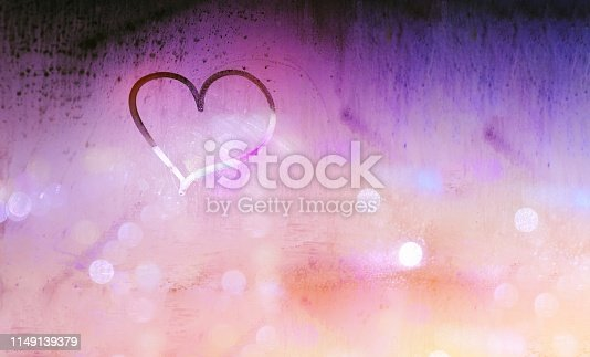 Abstract colorful love background, hand drawing of heart on the misted window, romantic message for lovers, Valentines day holiday, passion and desire concept. Trendy ultra violet color
