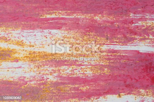 istock Abstract colorful paint background on an old wooden plank wall 1035609082
