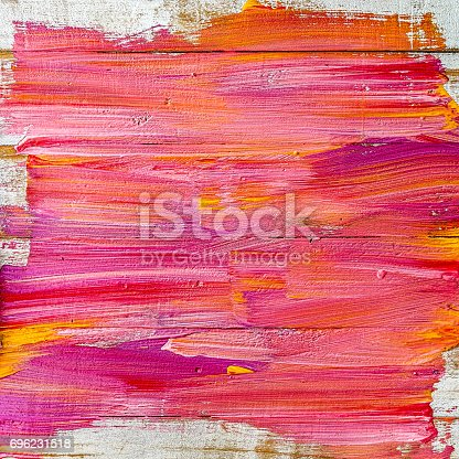 istock Abstract colorful paint background on an old wooden plank wall. 696231518