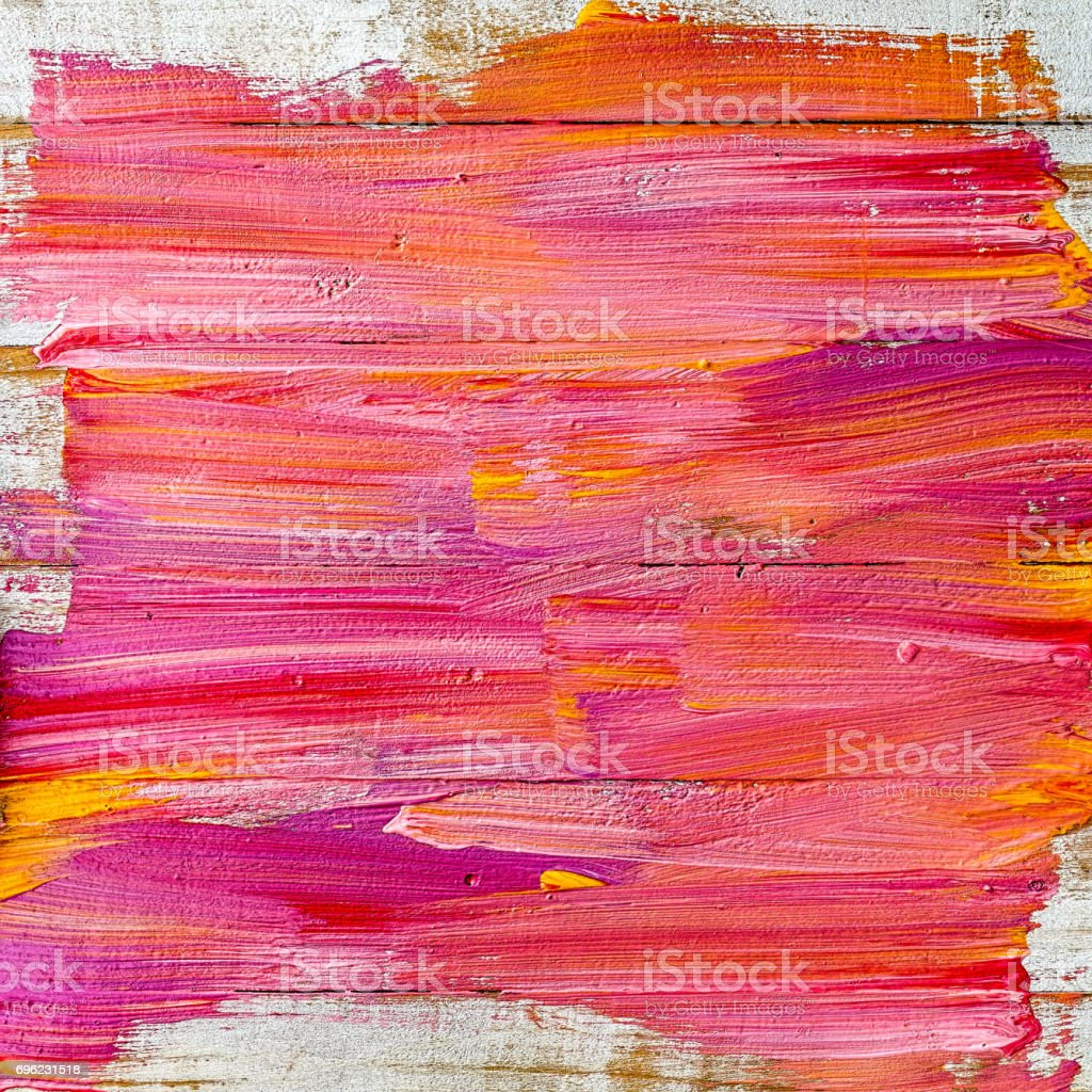 Abstract colorful paint background on an old wooden plank wall. stock photo