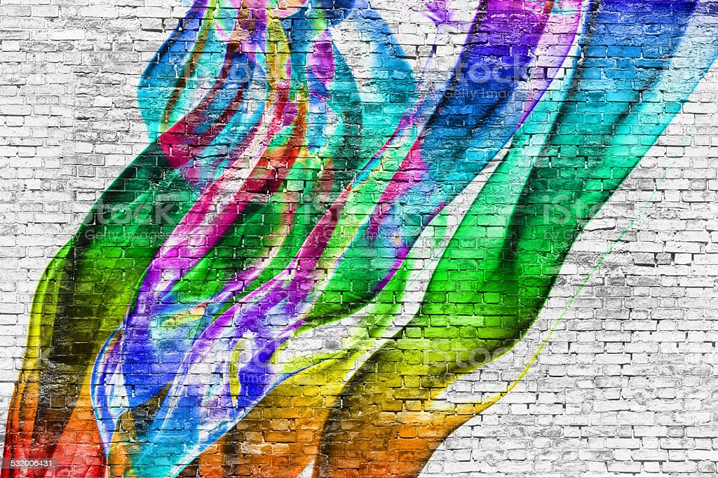 abstract colorful painting over brick wall stock photo