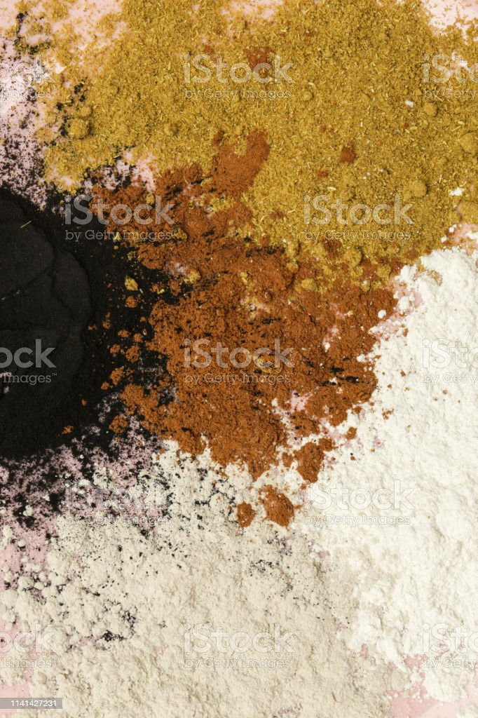 Abstract colorful powder background, close up view of mixed powders,...