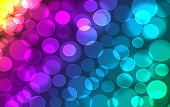 """Abstract colorful rainbow defocused, blurred bookeh lights effect texture, background. Yellow, red magenta, violet, blue green blurry round shapes. Universal template wallpaper""""n"""