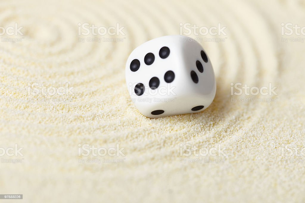 Abstract composition in sand with white dice - Zen Garden royalty-free stock photo