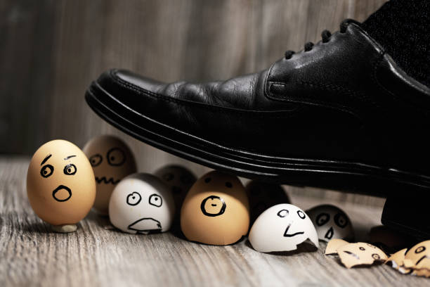 Abstract composition of business leadership. Abstract composition of business leadership. Broken eggs under mans shoes. governing board stock pictures, royalty-free photos & images