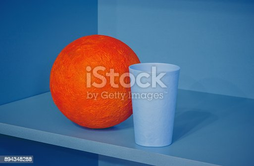 1127798356 istock photo Abstract Composition With Orange Ball 894348288