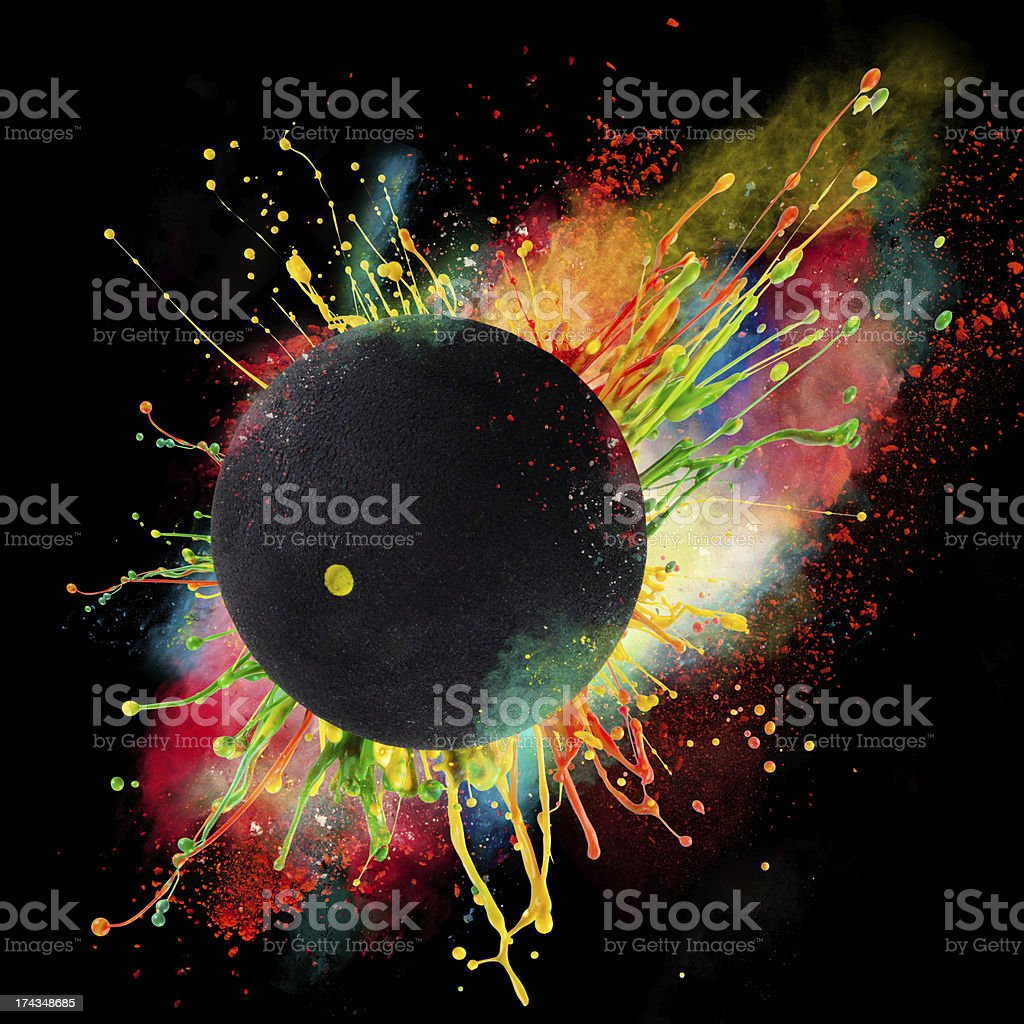 Abstract concept of a ball bouncing in colorful paint stock photo