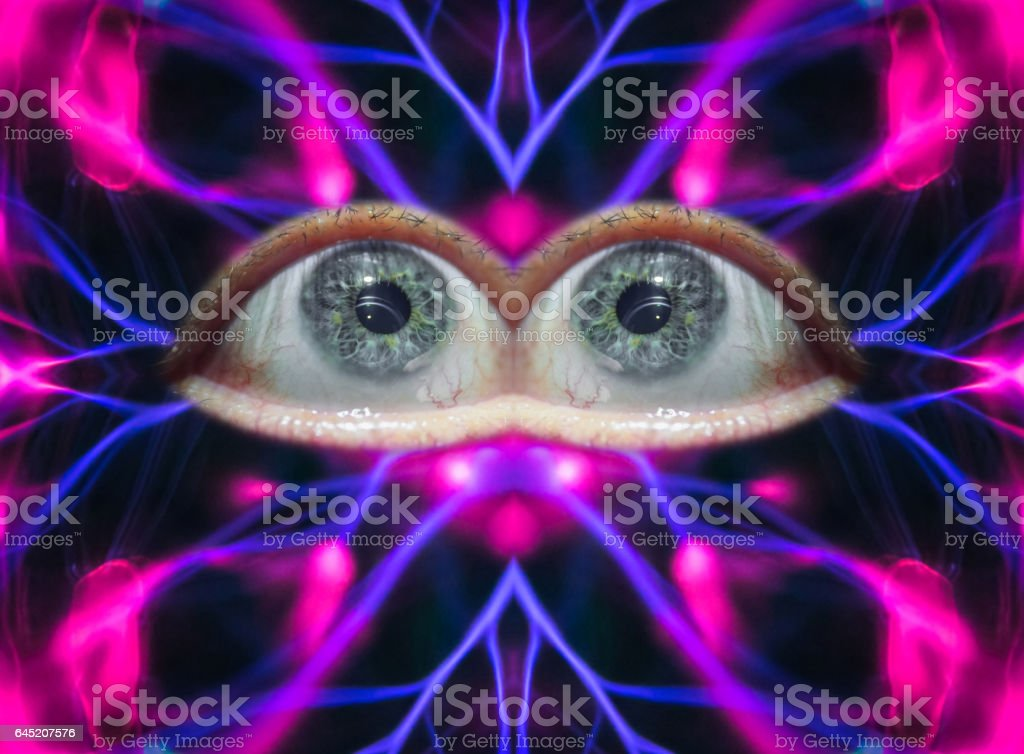 Abstract concept of energetic human eyes on colorful plasma background stock photo