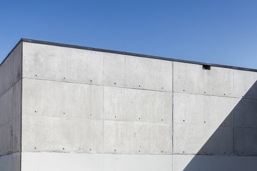 Abstract concrete interior, corner under sky