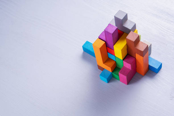 Abstract construction from wooden blocks. Colorful wooden building blocks. Abstract construction from wooden blocks shapes with copy space. The concept of logical thinking, geometric shapes. Colorful wooden building blocks block shape stock pictures, royalty-free photos & images