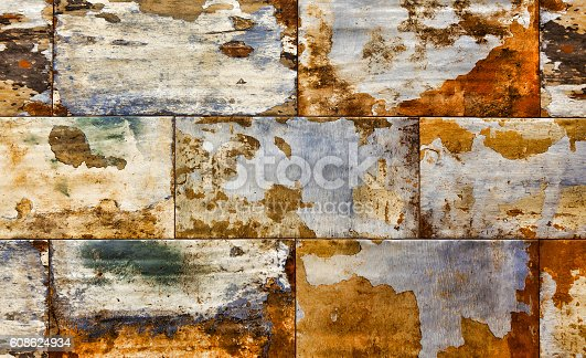 636061068 istock photo Abstract corroded colorful rusty background, old wall texture 608624934