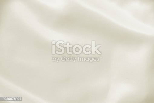 Abstract crumpled white light cream yellow wedding background with silk, satin or cloth folds and drapes fabric texture. Luxury cloth,wavy grunge satin textured velvet material or luxurious Christmas holiday.