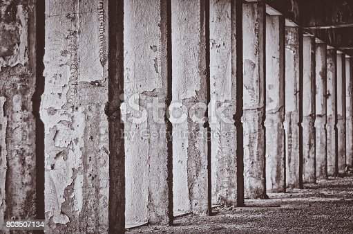 istock abstract damage cement columns 803507134
