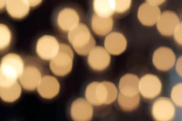 abstract dark backdrop with defocused warm lights - flare foto e immagini stock