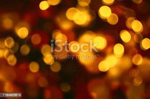 857847778 istock photo Abstract defocused circular golden luxury gold glitter bokeh lights background. 1184603814