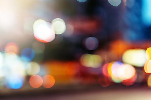 517687466 istock photo abstract defocused city street scene at night 514620440