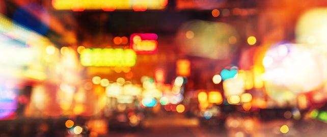 517687466 istock photo abstract defocused city street scene at night 521045288