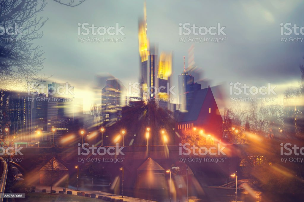 Abstract defocused city street scene with Commerzbank Tower and Alte Brucke at night in Frankfurt am Main stock photo