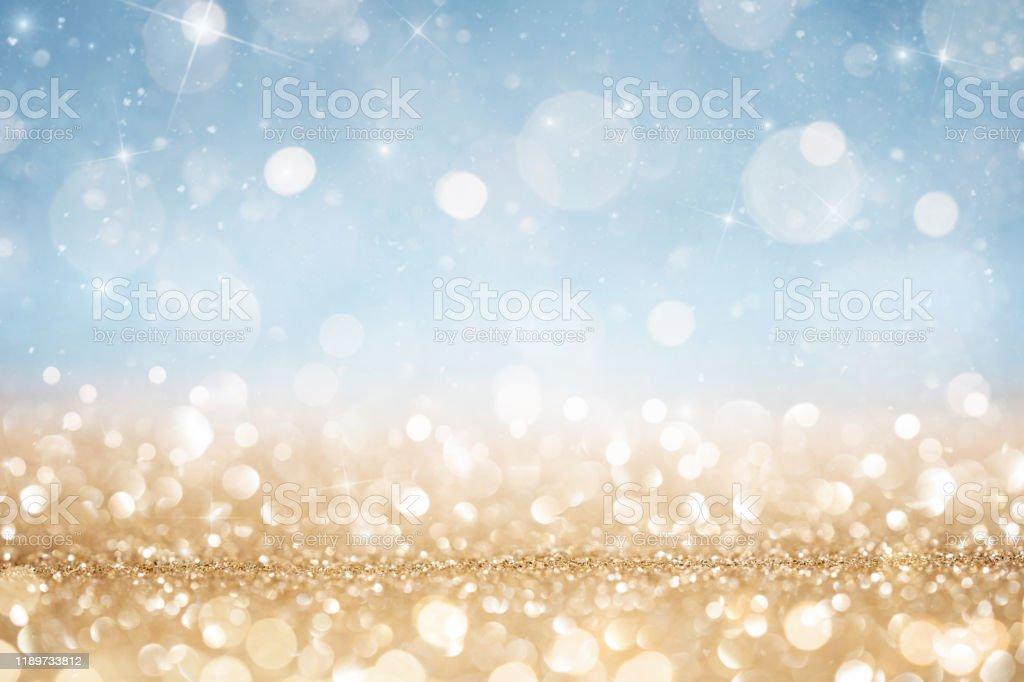 추상적 인 데초점 골드와 블루 반짝이 배경 - 로열티 프리 0명 스톡 사진