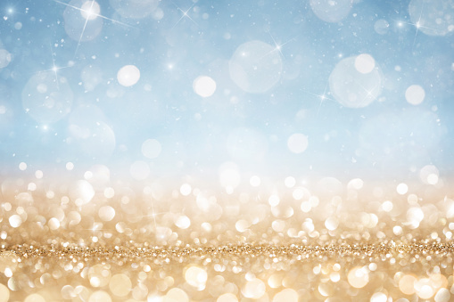 Abstract defocused gold and blue glitter background
