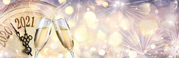 Abstract Defocused New Year 2021 - Countdown And Toast With Champagne And Clock stock photo