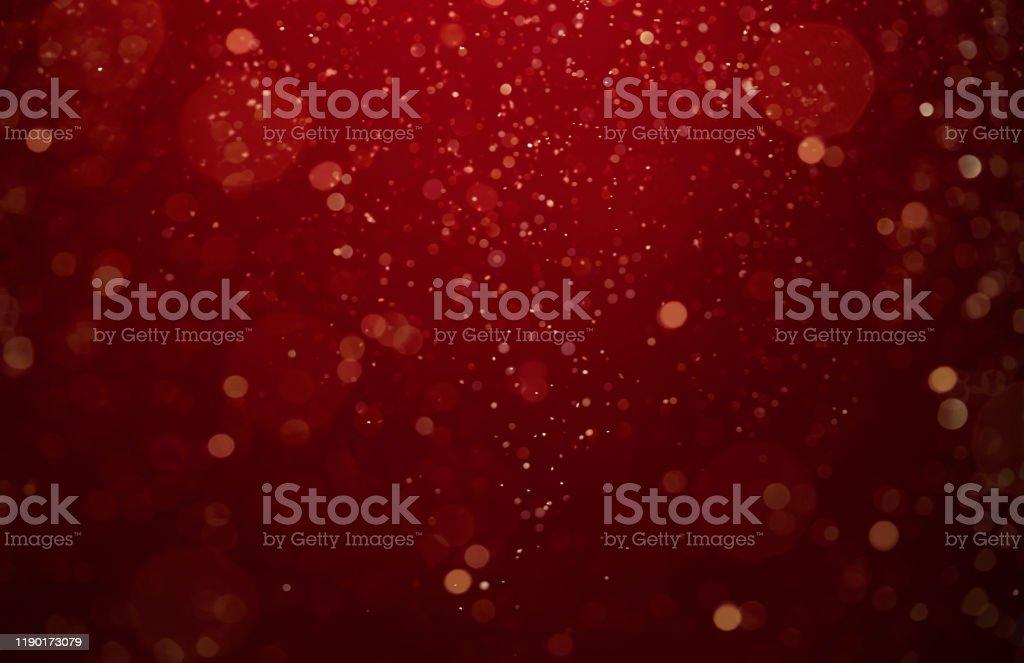 Abstrakter, defokussierter roter und gold glitzernder Hintergrund - Lizenzfrei Abstrakt Stock-Foto