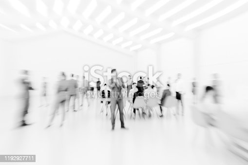 Abstract defocused shapes of office business people. This is entirely 3D generated image.