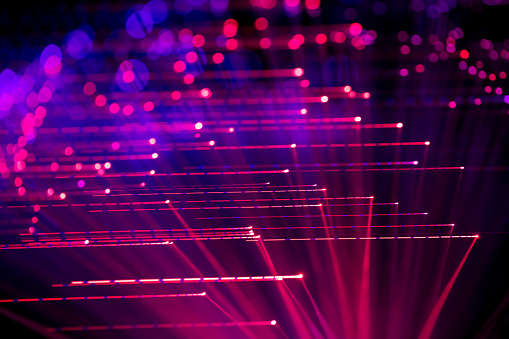 Abstract background with defocused lines and spots in blue - purple tones. Fiber optics.