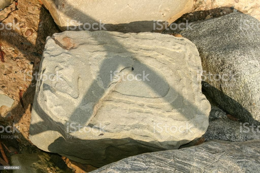 Abstract design formed by erosion on a rock. stock photo
