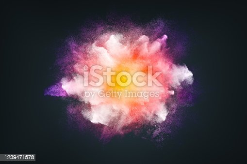 862273526 istock photo Abstract design of bright colored powder cloud on dark background 1239471578