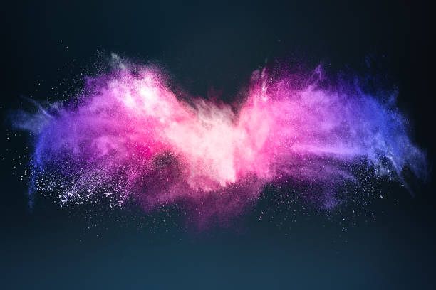Abstract design of bright colored powder cloud on dark background