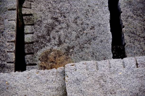 abstract design of lines and squares created by blocks of granite on the breakwater at ogden point - granite rock stock photos and pictures